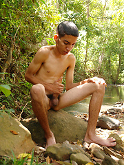 Pablo Torres is a slim sexy latin twink who sitting by a stream naked and stroking cock