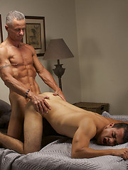 Alex tosses Rick on his back and slides his big dick in his tight little hole